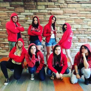 peer educators wearing red hoodies