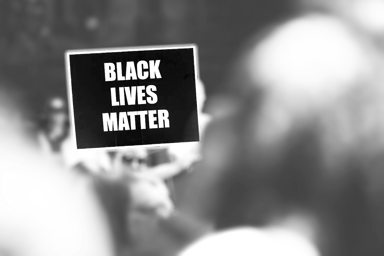 black and white sign that reads Black Lives Matter